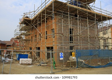 Construction of new houses with scaffolding in Bristol, UK