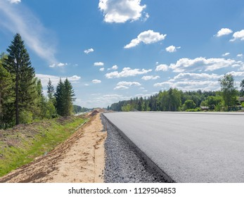 Construction of a new large long asphalt road in rural areas with sand and gravel technology in Russia