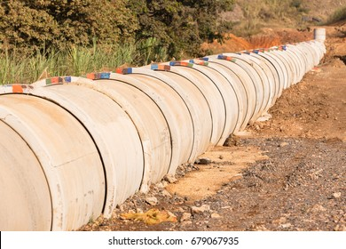 Construction New Pipeline  Construction new concrete pipeline for waste water through countryside landscape vegetation.
