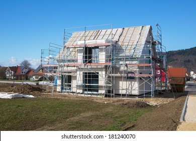 Construction of a new prefabricated house of stone and wood.