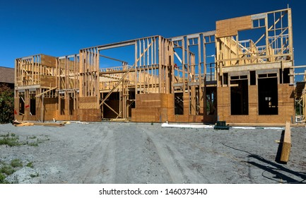 Construction of a new private wooden house in a residential area. Construction of the house at the stage of the foundation laid and the beginning of the framing works on the walls