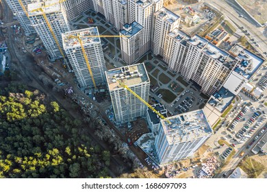 construction of new residential area near city park. high-rise apartment buildings under construction. drone point view
