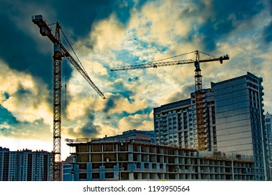 Construction of new residential buildings against the sky . The concept of the construction business .
