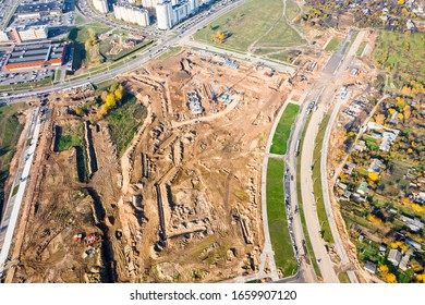 construction of new residential district with apartment buildings and new city highway. big city construction site. aerial top down view
