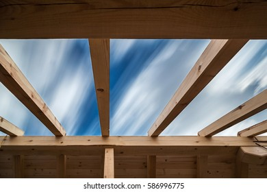Construction of new roof of house under blue sky
