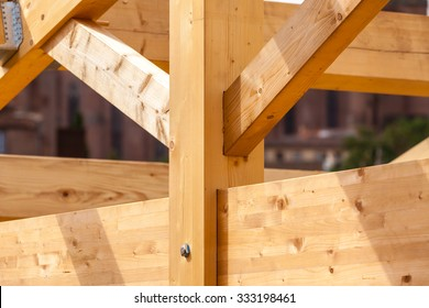 Construction of new wooden house. Beams frame close up