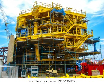 Construction of oil and gas drilling platform in the shipyard at blue sky background.