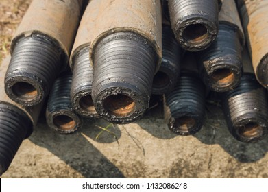 Construction of Oil and Gas Pipeline,horizontal directional drilling.Drilling of oil and gas wells.In the foreground,a threaded joint of pipes.Rust is visible on the pipes.