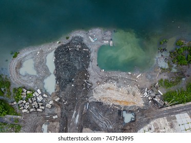 Construction on the river shore. Water pollution from aerial view. Ecological problem on Tom river. Tomsk, Russia