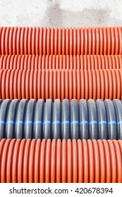 Construction orange and black plastic pipes