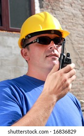 Construction personnel using radio to communicate