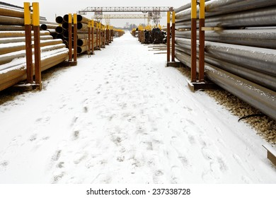 construction pipes on outdoor warehouse in winter