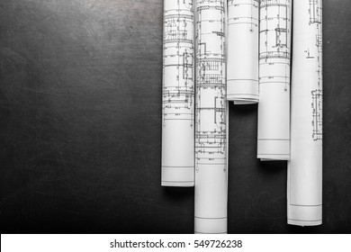 Construction planning drawings on black background