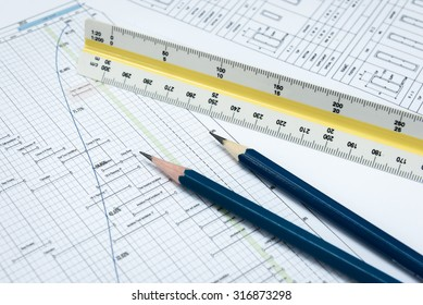Construction planning work.Planning paper with the triangular scale ruler and pencil.