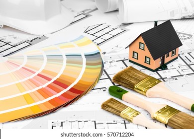 Construction plans with whitewashing Tools Colors Palette and Miniature House on blueprints; Building and Construction Industry Concept