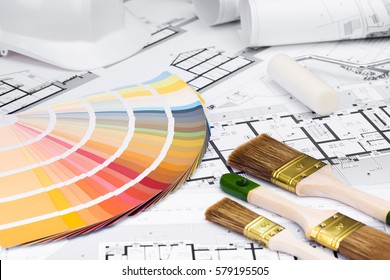 Construction plans with whitewashing Tools and Colors Palette on blueprints; Building and Construction Industry Concept