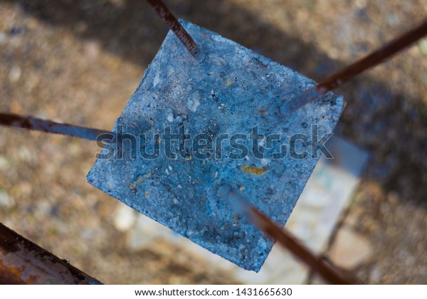 construction pole with cement and rebar metal rods
