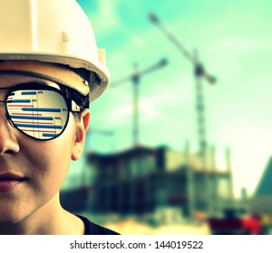 Construction project, construction manager with eyeglasses reflecting project planning
