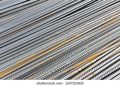 Construction rebar steel work reinforcement in concrete structure of building. Natural background texture.