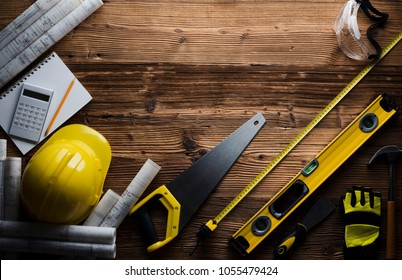 Construction and renovation concept. Contractor tools, on wooden table. Top view shot.