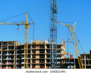 Construction of a residential complex. Construction of multi-storey  building.Two cranes near building.