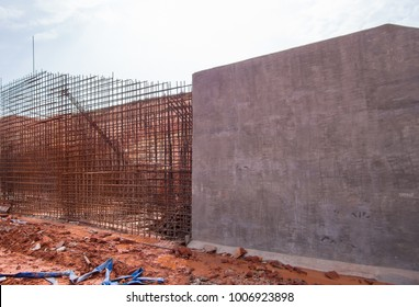 The construction of a retaining wall (counterfort). Reinforced. Preparation to pour concrete. Construction site. Construction of irrigation structure.