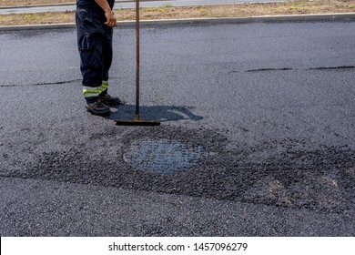 Construction road worker during asphalting works