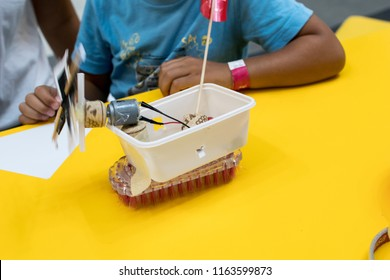 construction of a robot from waste materials. STEM activities for children on technology, electronics, robotics and circular economy. Recycling of waste materials for educational scientific activities