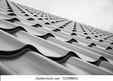 Construction of the roof of the house. Metal tiles