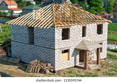 construction of the roof of the house, unfinished house of white brick