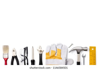 Construction safety equipment and tools on white background. Free space for text