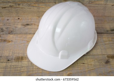 Construction Safety Hardhat Helmet on a wooden background