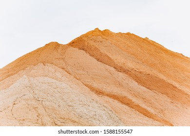 Construction sand mound quarry. A large sand mound in the mines.