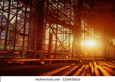 Construction Scaffoldings abstract scaffold with sunset in the background