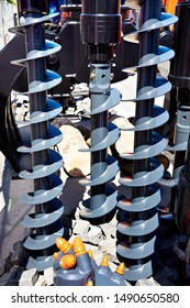 Construction screw augers for piles