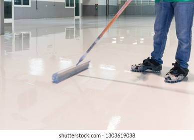 Construction series: Worker working on epoxy floor