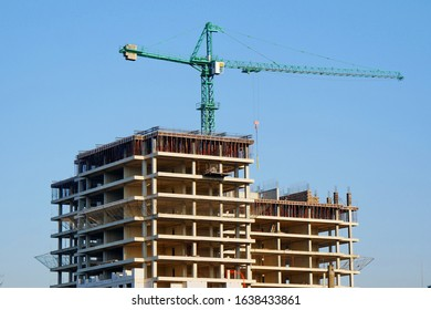 Construction site background. Crane and buillding activity.