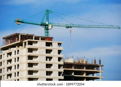 Construction site background. Hoisting crane and new multi-storey  building. Industrial background.