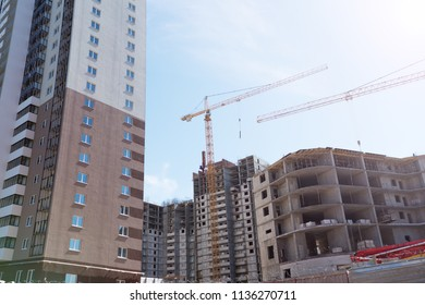 Construction site background. Hoisting cranes and new multi-storey buildings. I.ndustrial background.