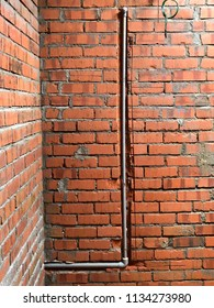 Construction site brick wall was hacking to insert domestic cold water by using UPVC pipe or HDPE pipe.