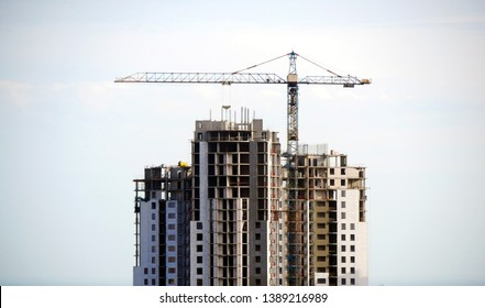 Construction site. Building site with crane. Concrete building under construction