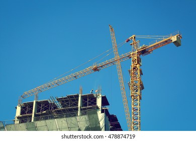 construction site building industry with machinery crane working and laborer worker