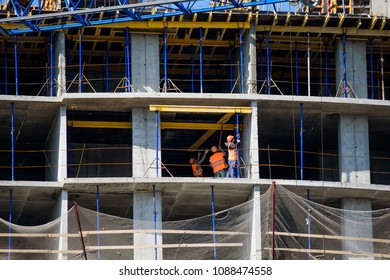 Construction site of building with scaffoldings