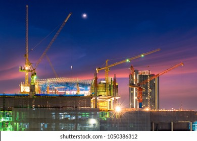Construction site busy operate in beginning of building new complex infrastructure project at twilight time.