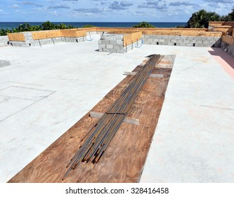 Construction site by the sea with rebar ready for installation.