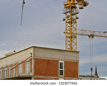 construction site in the city with a crane in the background