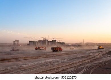 the construction site of coal washery,  dust was blowing at dusk
