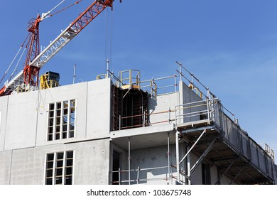 Construction site with crane in blue sky
