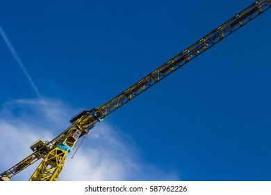 Construction site with crane and blue sky.