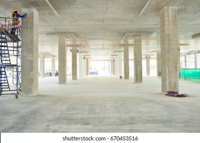 Construction site with crane and building floor flat slab.